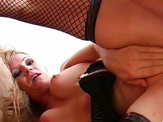 blond momma in red pants and fishnet nylons