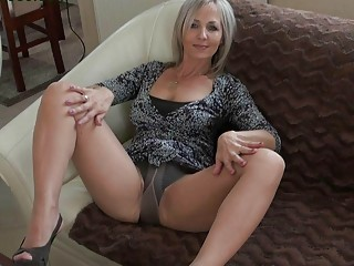 attractive golden-haired momma in hose does