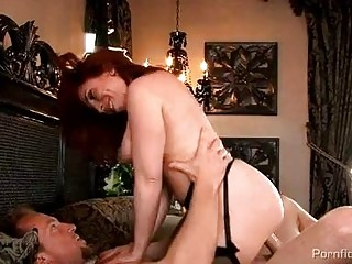 breasty redhead milf in stockings receives rammed