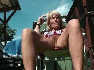unshaved mature smoker flashes her pussy and wazoo
