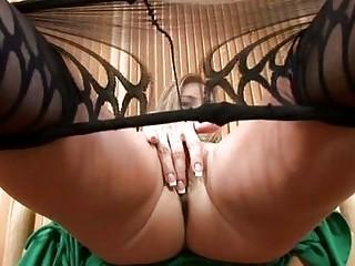 hot milf in pantyhose disrobes and masturbates